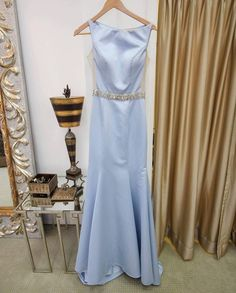 Having trouble finding a dress for your petite frame? This light blue gown in size 2 is classy and form fitting. With a rhinestone waist and sheer cut outs on the side you will look amazing in this Angela & Alison dress!