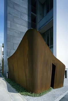 """Tomigaya Apartments"" (2005) garbage & bicycle shed | Shibuya, Tokyo • Satoshi Okada. Shed constructed of 1 cm thick Corten steel."