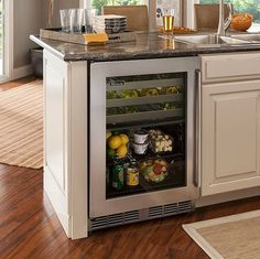 Wine Fridge - The Perlick 24-inch Signature Series Dual-Zone Refrigerator/Wine Reserve can store more than just wine. The indoor/outdoor fridge features a cold zone that can be used for food or beer storage.