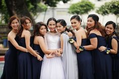 Midnight blue dresses are a dramatic contrast against the bride's white wedding gown. | From Michelle & Rogime's wedding, as featured on www.bridalbook.ph