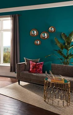 A rich teal hue of Behr Premium Plus Ultra coats the walls and ceiling in this l. A rich teal hue of Behr Premium Plus Ultra coats the walls and ceiling in this luxe master bedroom seating area. Get more teal paint inspiration. Room Paint Colors, Paint Colors For Living Room, Wall Colors, Paintings For Living Room, Bathroom Colors, Bathroom Ideas, Teal Living Rooms, Living Spaces, Teal Rooms