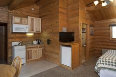 Our deluxe log cabins with a king bed and kitchenette offer a great retreat for couples! www.320ranch.com