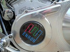 "Tech Enron. --- Book title page. ---  This is the Enron logo on a motorcycle.  Enron Broadband had such a motorcycle, nicknamed the ""Bandwidth Hog"", parked for a while in the lobby of its offices. ---  Image: Tech Enron / Flickr /  © 2011 Cara Ellison"