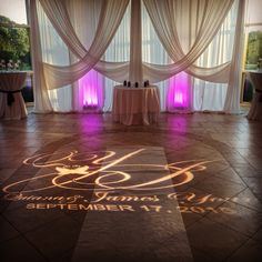 Wedding ceremony pipe and drape with swags, custom gobo and uplighting at Newton White Mansion in Maryland