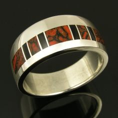 Handmade sterling silver wedding band inlaid with dinosaur bone and black onyx. There are 5 pieces red dinoaur bone and 4 small pieces of black onyx. The dinosaur bone inlaid in this ring is red celled with black matrix. Dinosaur Bone Ring, Dinosaur Bones, Sterling Silver Wedding Rings, Silver Jewelry, Bone Jewelry, Australian Opal Jewelry, Mens Ring Sizes, Thing 1, Turquoise Rings