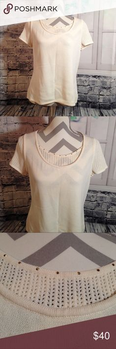 """Chic St. John Knit Top Chic St. John Knit Top! It's white but has a cream color also. This top is really cute and chic! Has lovely subtle hold decoration on top!In excellent condition! This top doesn't have size but it looks like Medium. I also have measurements. This top is about 23"""" and the Bust is 19"""". Any questions, please ask! St. John Tops"""