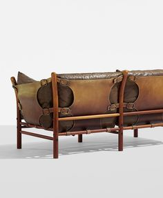 ARNE NORELL, Inca sofa, Norell Ab, Sweden, c. 1965. Leather, stained beech, nickel-plated brass.