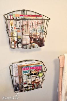 Bicycle baskets hung to display magazines and books.