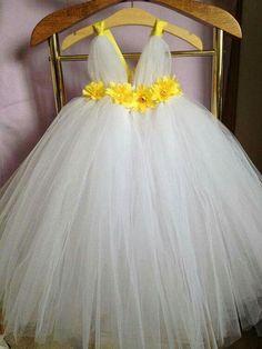 white tutu with yellow flower sash