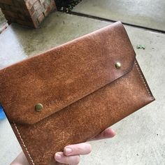 Hand stained. Hand stitched. In my hand. It's quite handy! Big enough for a phone your keys and a little lip gloss! #handcrafted #leatherclutch #leathercraft #leathergoods by eleven10leather #tailrs