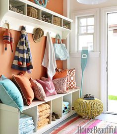 this is so welcoming!  i love it!  colorful pillows, outdoors gear, floating shelves, colored walls,...<3