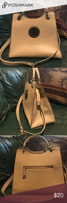Large leather tote handbag Beautiful cream colored tote bag. Comes with adjustable and removable straps so you can wear it as a shoulder bag or carry it as a handbag. Has a tiny, unnoticeable scratch in the back bottom left other and a small pen mark in the back bottom right corner as indicated in the pic. Other than that, bag is in great condition. Bags Totes