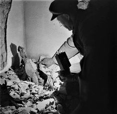 These people died in the attack on Dresden on February 13, 1945. Due to the extreme heat of the fires during the bombing of this air raid shelter was deprived of oxygen and thus these people were suffocated but also mummified at the same time. These photographs were taken in 1952 when this room was accidentally discovered during construction.