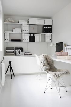 White home office with white floors.