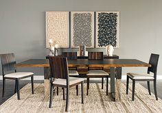 Opposites Attract: This dining room easily bridges the gap from earthy to modern with this unique table. Versailles Dining Table, $1,799. Benjamin Moore Chelsea Gray