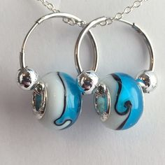 New Murano Glass Bead Earring Silver LampworkCharm New Murano Glass Bead Earring .925 Silver Lampwork ~Pandora Style Charm~Hoop Earring~ Color Blue and White Bead~ Comes in Sheer Jewelry Bag~Gift Ready! Murano Jewelry Earrings