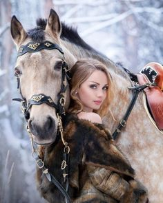 Lady and sweet horse in the snow.