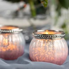 Accentuate your vintage romantic pink table decor with pink ombre mercury votive candle holders. Featuring a metal beaded rim, the candle holder will product a soft and romantic glow throughout your venue.  #VintageCandleHolders #RomanticCandleHolders #VintageTableDecor
