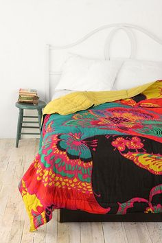 lover the colours in this Boho Floral Quilt from Urban Outfitters, £95.l00