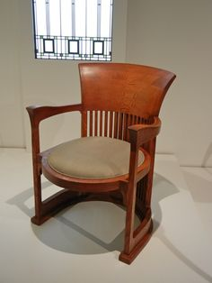 This Barrel Chair was designed by Frank Lloyd Wright, circa 1904, with oak. It was originally designed for the Darwin Martin House in Buffalo, New York. Frank Lloyd Wright and the Martin Brothers -Darwin and Martin, had a long lasting relationship that resulted in numerous commissions. Darwin Martin was Wright's ideal client, with deep pockets.