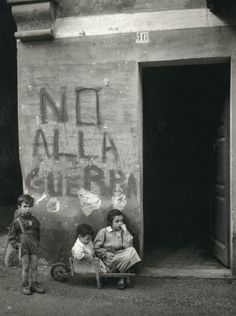 """""""No alla guerra"""" (""""No to war"""") written on the wall of an Italian village which saw fighting during WWII.  Italy - 1950.  (Photo byWerner Bischof)"""