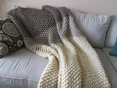 Crochet Blankets For Men A super bulky yarn and simple seed stitch combine to make a timeless, quick to knit keepsake.This blanket is knit in one piece from the bottom up in 3 different colors. The pattern has 2 sizes. Crochet Mittens Free Pattern, Crochet Blanket Patterns, Knitting Patterns Free, Knit Patterns, Afghan Patterns, Knitting Ideas, Circular Knitting Needles, Arm Knitting, Loom Knitting Blanket