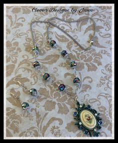 FUF 3/3 .. B'sue by 1928 Pewter Bezel and I painted it using Swellegant Paint .. A B'sue vintage cab fits perfect into the Bezel .. Brautiful glass beads and silver plated chain complete this necklace.. Clever Designs by Jann