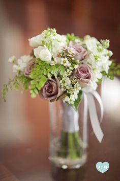 Polo roses, freesia, lilac, maidenhead fern, tea roses, orinthalgium arabicum and anemones