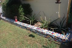 Sweet Moments in Thyme: Fun Garden Accents | mosaic covered cinder block garden wall edging