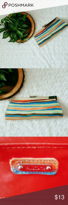 """Bold and Fun Aldo Clutch This bold and fun Aldo clutch will make a statement at brunch with the girls.  Push lock closure Bottom width - appx. 12"""" Height- 5"""" Side slip pocket w/clean lined interior Optional shoulder strap  Excellent Used Condition. Used twice.  No Trades! Bundle and Save! Inquire below with questions with exception of pricing. Hit the offer button and let's make a reasonable deal. This is a steal!  Thanks for looking, shopping, and saving! Aldo Bags Clutches & Wristlets"""