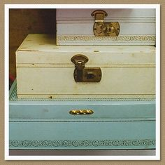 vintage jewelry boxes -- I had one like the one in the middle. It had a dancing ballerina in it, which popped up and twirled in her mirror, while music played.