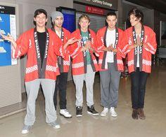 Konnichiwa! One Direction arrive at Narita International Airport in Japan.