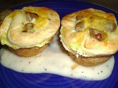 """Biscuit and Gravy Breakfast Cups  1 pkg. 8 count canned biscuits 8 sausage links, cooked 1 pkg. peppered gravy mix 2 eggs 1/4 C. milk 1/2 C. shredded cheddar cheese pinch of salt and pepper  Using a rolling pin, flatten each biscuit to a 4"""" round and gently press into a greased muffin tin.  Make gravy mix according to directions.  Beat together the egg, milk, salt and pepper.  Place 1 T. of the gravy mix in the bottom of each bread cup.  Use 1 sausage link, sliced, per cup.  Sprinkle the ..."""