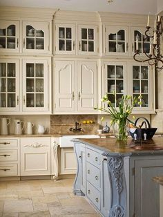 Like the design details and the different colored island ~ dream kitchen. Just need more space under the cabinets