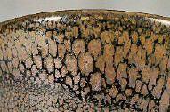 Bailey's Oil Spot Cone 10/11 25.51 Custer Feldspar 35.71 NC-4 (Soda Feldspar) 15.30 EPK Kaolin 5.10 Talc 5.10 Dolomite 5.10 Ferro Frit 3110 6.00 Red Iron Oxide Cup Bailey's Oil Spot Grolleg porcelain Cone 11 oxidation