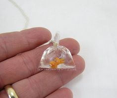 somehow how this is freakishly cute and weird at the same time :) Goldfish In A Bag Necklace by CuteAbility on Etsy, $24.00