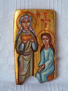 Saint Martha and Saint Mary of Bethany the sisters of Lazarus, friends and disciples of Jesus. I used an originally way to picture them, St Martha, taking care of everything, holding a loaf of bread, St Mary, sitting, listening...