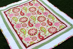 "Paisley Baby Quilt (Front) 40x50"". Available for custom order ($75) through: www.etsy.com/shop/darlingmushroom. Any central fabric design is possible."