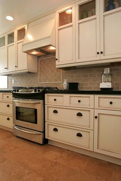 Whitewash Cabinets With Dark Knobs And Countertops I Don T Care About Stainless Steel But