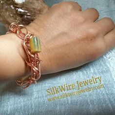 "Rockin' Krobo Bead on Copper Bracelet by SilkWire Jewelry. Bendable & adjustible up to an 8"" wrist  #handmade #jewelry #copper #bracelet #blackowned #boho #African #accessories"