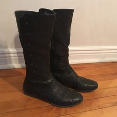 Tall black boots Well loved and well taken care of tall black boots.  They are Borns so they are unbelievably comfortable!! Some wear spots as pictured.  Good grippy soles. Born Shoes