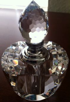 """My gorgeous lead crystal perfume bottle. The stopper screws on, and has a glass """"dipstick"""" attached. The antique shop couldn't date it for me. Crystal Perfume Bottles, Antique Perfume Bottles, Olive Oil Bottles, Beautiful Perfume, Bottles And Jars, Leaded Glass, Sparkle, Collections, Treats"""