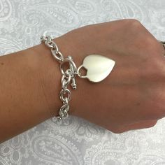 "Silver Charm Bracelet Silver link chain with heart charm. Loop and bar closure. 7"" long. Jewelry Bracelets"