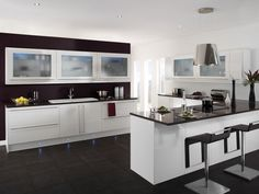 Fascinating modern #kitchen #design matched with black and white kitchen cabinet combination create a comfort place for having meals Visit http://www.suomenlvis.fi/