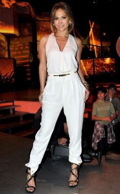 Jennifer Lopez - Simple white jumpsuit with metallic shoes and belt.