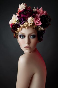 """eyes, flowers, skin... she looks """"caught"""" in the middle of something. That expression just draws you in."""