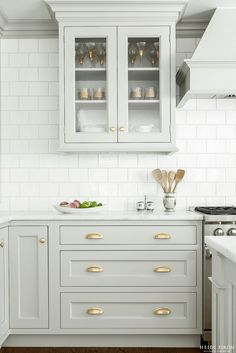 Looking for some grey and gold kitchen inspiration? Here's a sneak peek at our grey and gold kitchen renovation + the images that inspired me! Two Tone Kitchen Cabinets, Kitchen Cabinet Design, Kitchen Interior, New Kitchen, Kitchen Cabinetry, Kitchen Backsplash, Kitchen Ideas, Backsplash Ideas, Backsplash Design