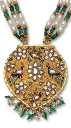 A diamond, emerald and enamel necklace the shield shaped panel with table-cut diamond floral clusters and blue and red enamel peacocks suspending a cultured pearl and emerald fringe, completed by an emerald bead and drop-shaped cultured pearl necklace; mounted in eighteen karat gold plate; length: 24in.