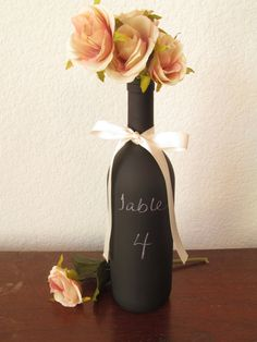 We've seen a lot of trends with chalkboard paint! Loving this table number decoration-------Chalkboard Wine Bottle / Wedding Table Number / Party Supply Chalkboards / Decorative Wine Bottle Fall Wedding, Diy Wedding, Wedding Flowers, Dream Wedding, Wedding Stuff, Wedding Photos, Chalkboard Wine Bottles, Chalkboard Paint, Chalkboard Table