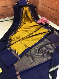 Looking for an elegant look in the evening parties, try this Golden Yellow and Midnight Blue color combination Dupion Silk Saree. This latest silk mark certified collection is very lightweight and nicely woven.
